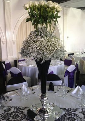 black vase with roses centrepiece