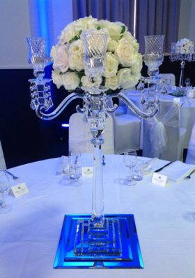 four arm crystal candelabra with roses