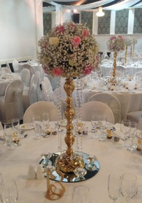 gold galaxy stand with roses and gypsophila centrepiece