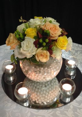 fresh flowers in round vase with pearls