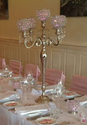 five arm candelabra with pink theme lights