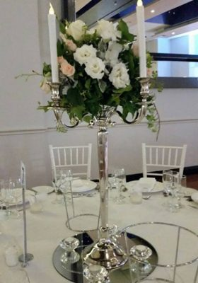 silver candelabra with floral arrangement