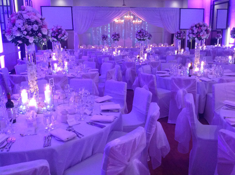 wedding centrepiece with candles and flowers