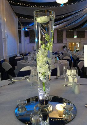 vase centrepiece with orchids and floating candle