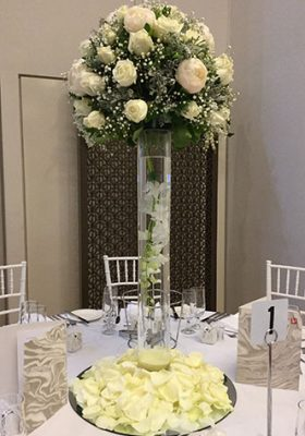 white floral centrepiece arrangement in tall vase
